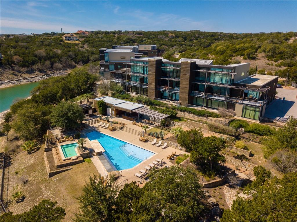 Serene lakefront resort-style community on beautiful Lake Travis! This waterfront condo has amazing hill country and lake views from the balcony/patio! High ceilings and walls of windows give it a bright modern feel. Stunning kitchen features farmhouse apron-front sink, high-end cabinetry, and granite countertops. Breakfast bar open to family room for seamless entertaining. Primary bedroom + guest bedroom on 2nd level with 1 guest bedroom on 1st level. Recently installed motorized solar shades in living room and primary bedroom. The luxurious Waterstone community offers an infinity-edge pool overlooking lake, private day dock, swimming pier, fire pit. (Nearby public golf course in Lago Vista!) This unit has a detached 2-car garage. Perfect weekend getaway & lake lifestyle home! (Note: No short term rentals less than 3 months permitted.)