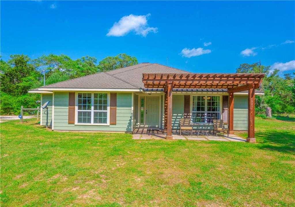 This hidden gem in a country setting is just minutes from Austin. Excellent for wildlife viewing or a hunting lease. There is a trail around the property for walking, biking or ATV's. A 20' deep, dry creek bed runs along the side of the property making it a great place for a shooting range. A nice Pergola covers the front patio of the home and inside you'll find wood and tile flooring, formal dining, spacious kitchen with breakfast area and a spacious living room. Owner's retreat offers an extended dual vanity, soaking tub and glass enclosed shower. There's a 25x50 shed on concrete foundation with a plumbed second story that could very easily be turned into an apartment for a second income. The property is 13.25 acre and has a 4 foot goat fence. There's also an acre that is fenced within the property and has RV hookups.