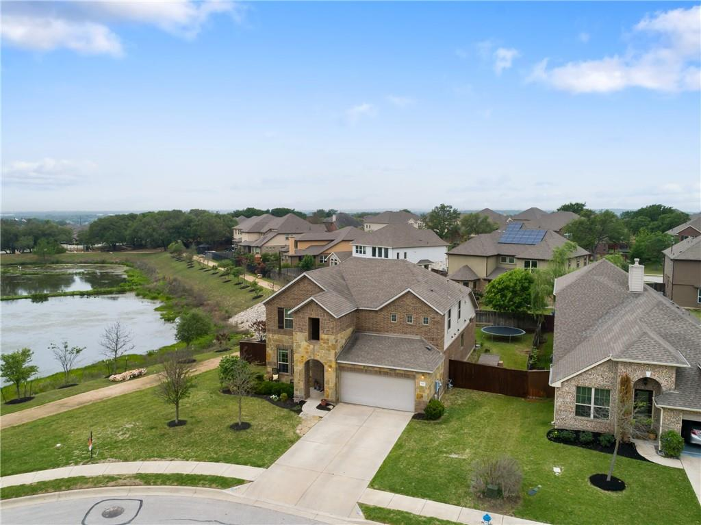 Beautiful 4 bedroom home on a large 1/4 acre lot~ cul-de-sac~ views of a peaceful pond. Spacious kitchen with a large island open to the living room with soarding ceilings. Upstairs bonus room and 3 large bedrooms with walk in closets. Spray foam insulated, energy efficient. Upgraded larger baseboards, iron staircase railing, and ceiling fans in all the rooms. Enjoy the extended deck and pergola for outdoor entertaing. Walking distance to community pool, park and Elementary school.