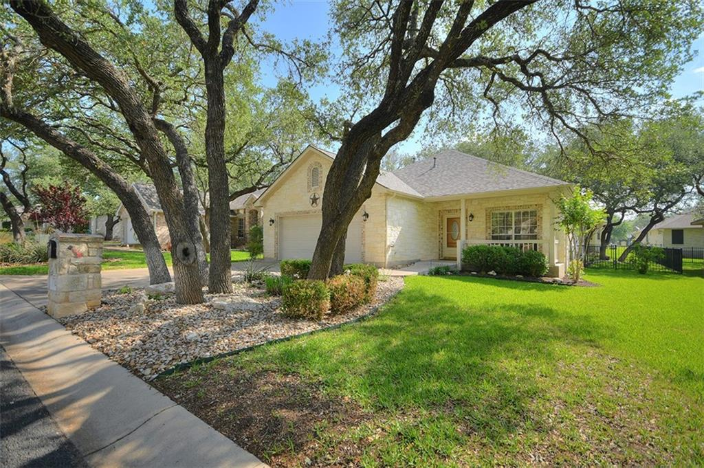 'Charming' best describes this adorable Jimmy Jacobs-built home located in Georgetown's 'Texas Traditions' 55+ community.  Located near shopping, restaurants, San Gabriel River Park, Lake Georgetown's Hike & Bike Trails, this 2 bedroom/2bath/2 car garage single level home is surrounded by native oak trees where sunlight dapples the front and back yards.  Tile floors are found throughout the living and wet areas of this home with carpet in the two bedrooms.  Living/Dining/Kitchen are nicely open to one another.  Stainless appliances, recent granite counter tops & backsplash and a corner sink which looks to the back yard add to the warm feeling of this home.  Meanwhile, the icing on the cake is the wonderful sunroom at the back of the home which is heated/cooled and can serve whatever your need may be - hobby spot, music room, tv/reading room - or simply a place to relax! Upgrades: Int/Ext Paint 2015, Porch Glass Enclosure/Shower Door 2015, Air Conditioner 2018, Sprinkler Control Box 2018, Garage Door Opener 2018, Kitchen Countertop/Backsplash 2019, Water Softener 2019,  Microwave/Cooktop/Dishwasher 2019, Roof 2020.  Note: No steps to front porch and no step into master shower.