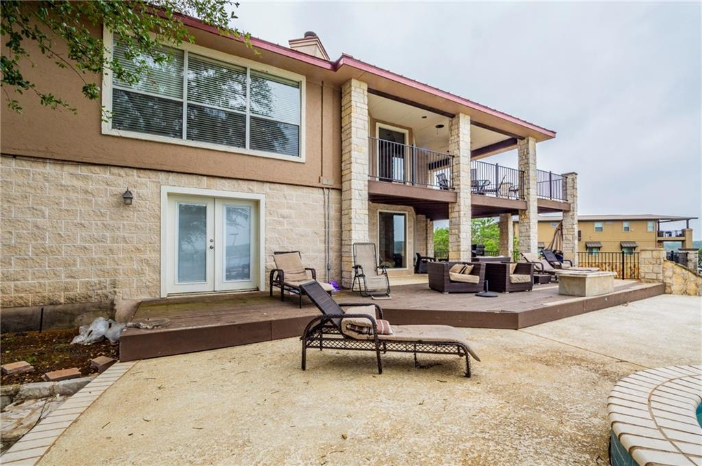 Gorgeous view abound from this wonderful 5 bedroom 3 bath lake front home. Multiple decks and a pool make this the perfect lakeside getaway. Need more space for yourself or potential renters? Finish out the apartment above the detached 4 car garage.