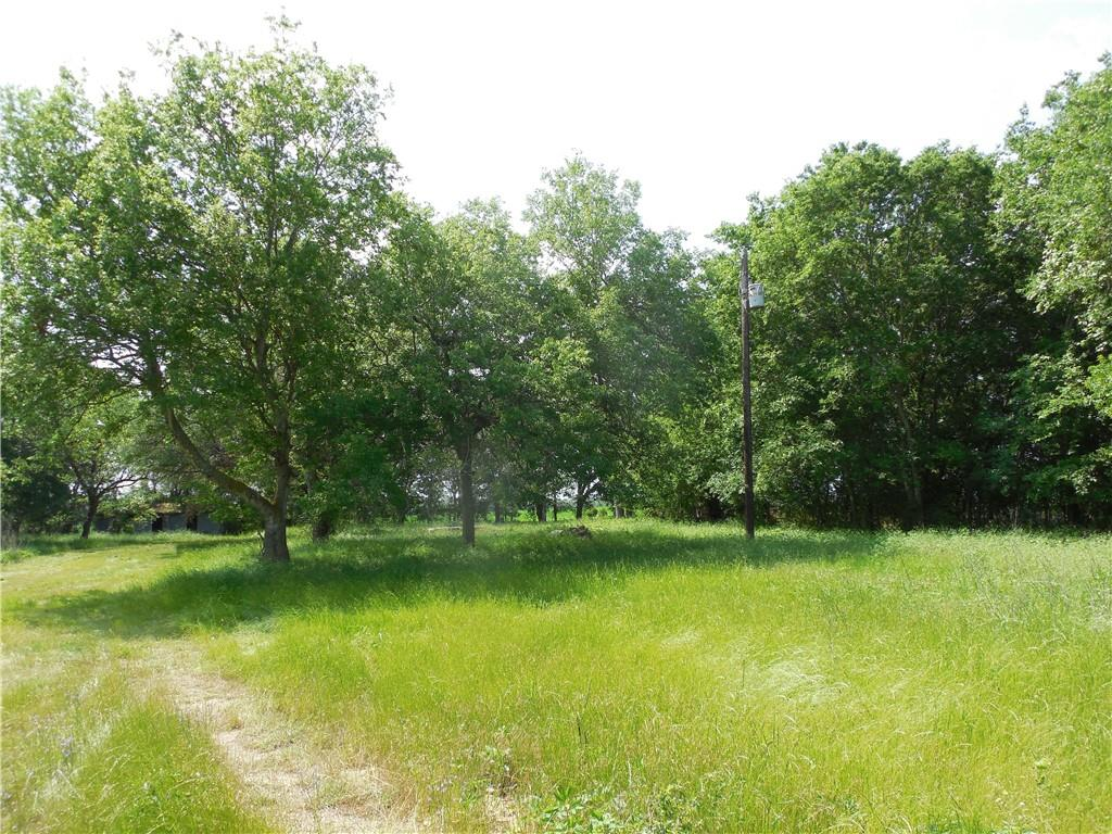 Potential very attractive secluded rural homesite overlooking excellent cultivated land fronting on Brushy Creek and potential rolling pasture when mesquite is cleared, established in grass, and fenced. Would make a beautiful view. Diamond in the rough. Private and quiet on end of county road, yet convenient to get anywhere quickly. The electric pole is still present but the electric wires were removed when one of the wires was on the ground. SW Milam water tap on site but no longer has active meter. Buyer's agent needs to verify if electrical and water service is still available. It is assumed the  old private septic system will not meet current codes. Old windmill negotiable.  Assessed value and taxes include residence that is no longer present. Buyer's agent must make initial contact and be present at all showings for full commission split.