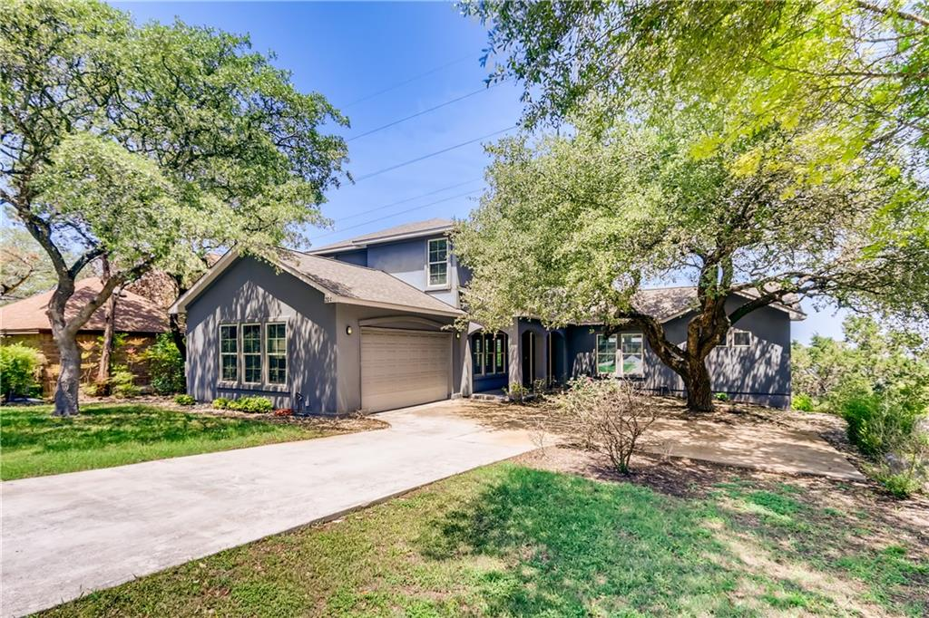 Click the Virtual Tour link to view the 3D walkthrough. Step into a spacious open floor plan. Easy to clean tile floors on the main level. Fireplace to gather around in the family room. Modern kitchen with eye-catching backsplash, center island, breakfast bar, and ample cabinet space. Primary suite on the main level features tray ceiling, large walk-in closet, separate tub and shower, plus double vanity. Upper game room offers extra space for daily function and entertaining guests. Large green backyard. Great location with easy access to trails, The Hills of Lakeway Golf Course, Hamilton Greenbelt, Lake Travis, and the rest of Texas Hill Country's beauty.