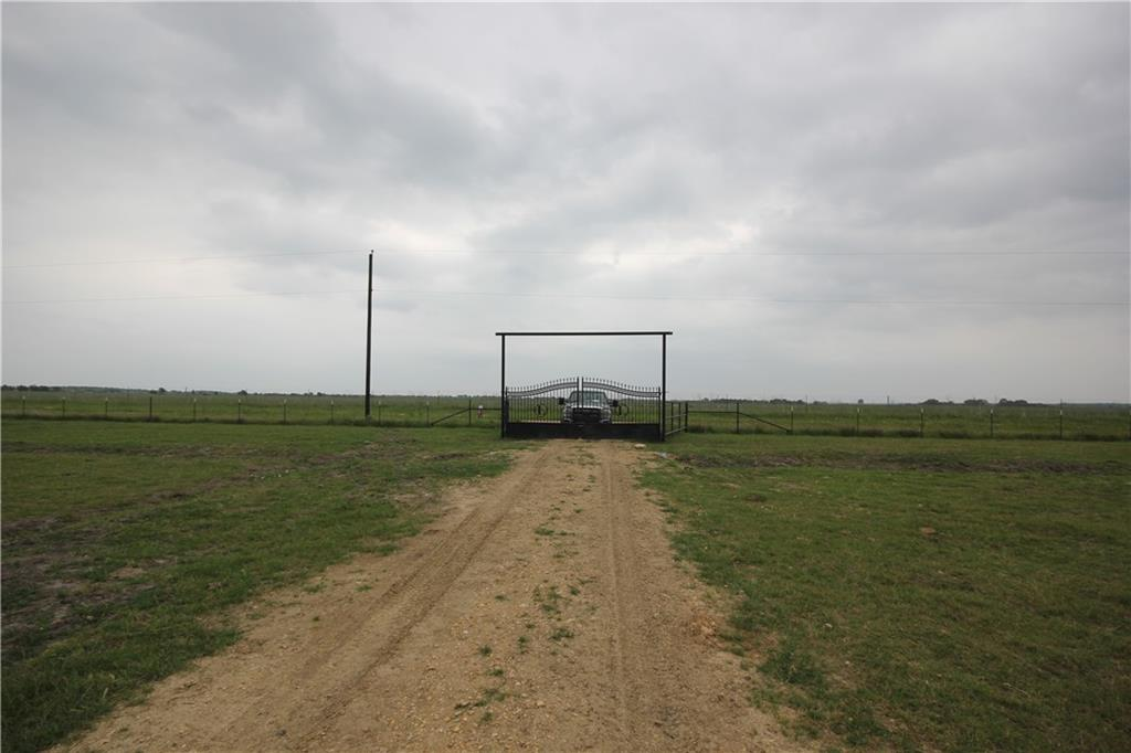 Really nice pasture with new net wire fence on the bottom and 2 barbed wires on the top.  Pond for watering cattle or fishing.  Water well and electric on property.  Secluded county road that dead ends so there won't be a lot of traffic.