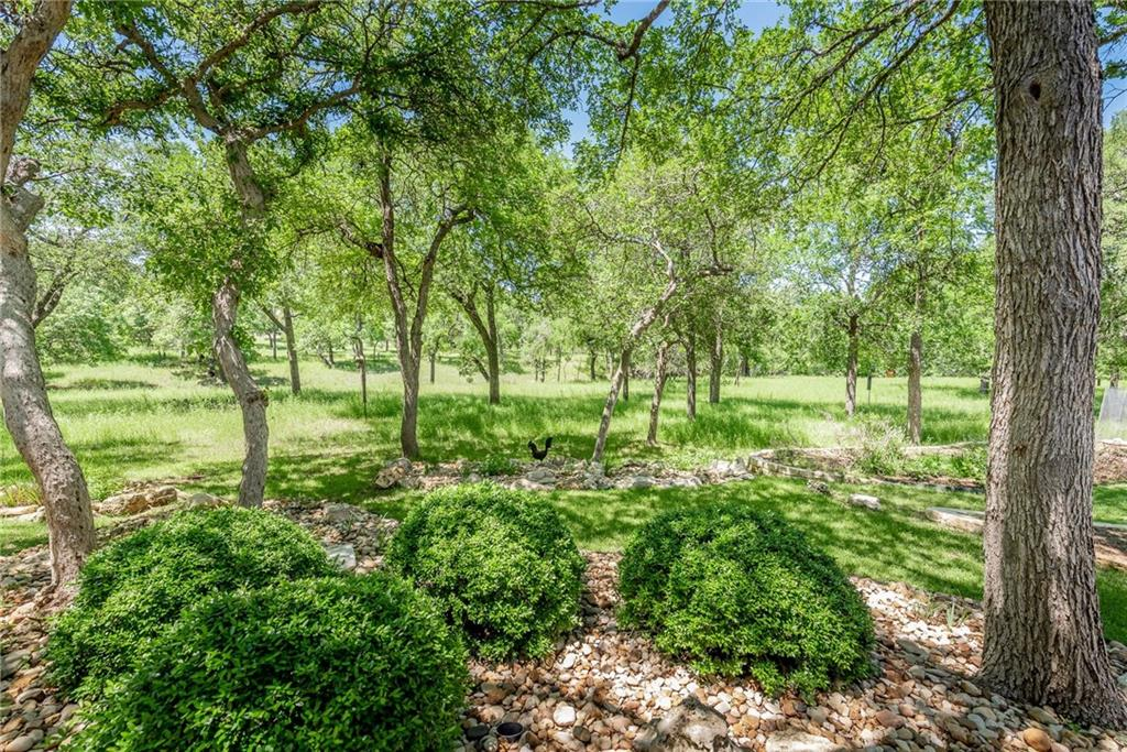 A greenbelt like you seldom see- like living in the woods! Privacy, views, serene, and scenic! Cypress model with tasteful updates- wood floors, granite countertops, plantation shutters and more! Roof 2020, AC/heat 2016, dishwasher 2020, microwave 2018, water heater 2021. This home is well-maintained and in a prime location in Sun City. Sellers will likely need a leaseback til end of June (not mandatory). See this one now- if you wait, it will be gone! GO Saturday and Sunday (no showings til Saturday 9 a.m.).