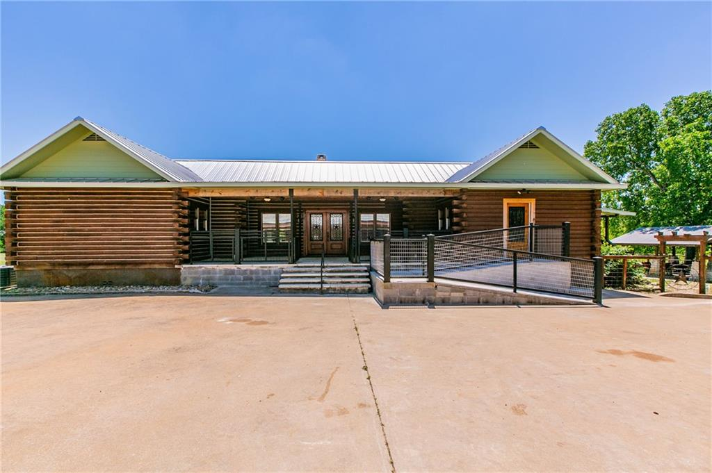 """Magnificent, updated log cabin style home with pool, garage apartments, horse stables, 2 ponds, 2 dry creeks, and more on 51.6 acres (2 adjacent lots (2408 & 2420 Dale LN) being sold together, 17.0 + 34.642 acres). The larger lot with horse stables is zoned agricultural. 15 minutes from Circuit of the Americas, 20 minutes from airport, 30 minutes from downtown Austin. The main house is simply gorgeous (3403 square feet). See attached documents for square footage and floor plans of house vs. garage apartments. Modern kitchen and bathroom remodels that are just magnificent. Gourmet kitchen is huge and breathtaking. 48"""" Wolf range, soapstone counters, custom cabinets, spacious pantry, large center island. This is open concept, spacious living (both indoors and out) at its best. Vaulted ceilings in main living areas are pine. All non-vaulted ceilings throughout the house are also all wood (cedar). No carpet. Floors all wood and tile. Large bedrooms. The primary bedroom suite is spectacular (with its own fire place). And that master bath! Enjoy the many outdoor living spaces. Enormous wrap around deck, pool, covered pool patio/entertaining area with fireplace, and more. Can you tell I'm excited about this listing? Whether you are """"horse folk"""", or simply looking for a spectacular home with land, you have to see this one. FYI, the 51.6 acres has some small areas within the 100 year flood plane. However, the living area structures and horse stables are not in or near any flood plane. Owners have never experiences any flooding at all anywhere on their 51.6 acres."""