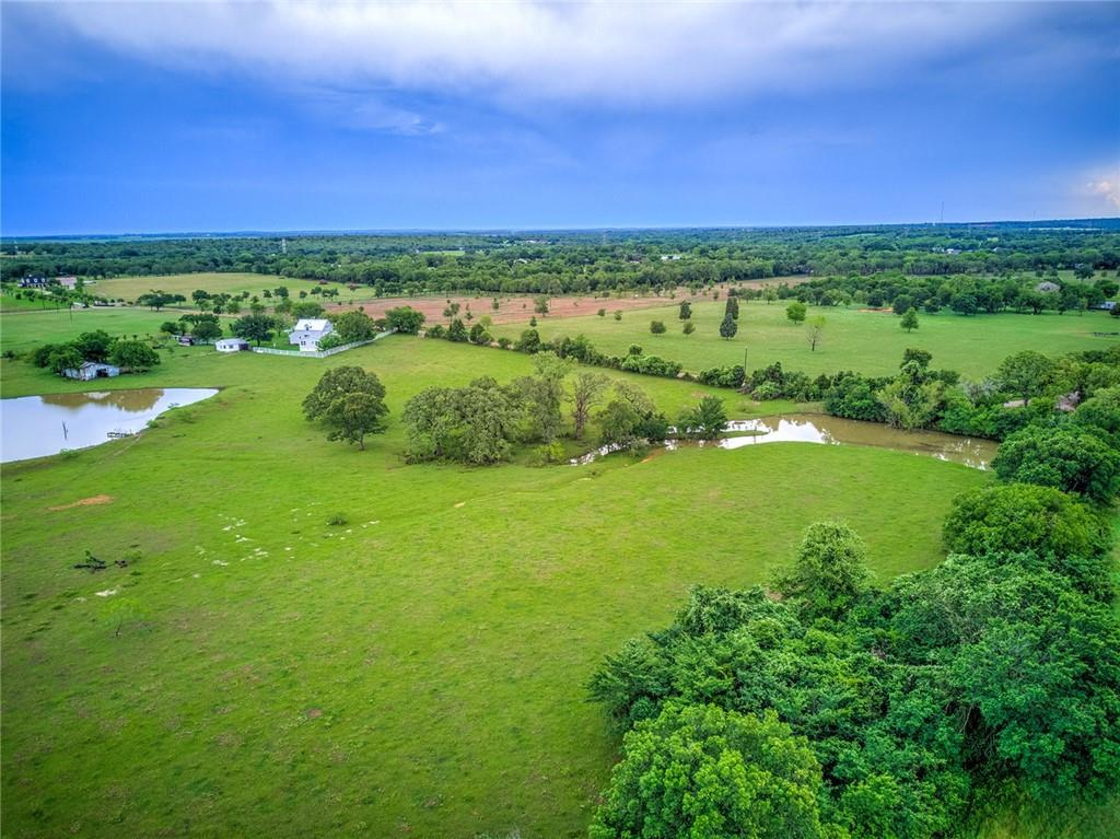 11.085 Acres.  4 miles outside of Elgin. Country living but close to the big city.  Beautiful property with a couple of building sites.  Two large stock ponds.  Under Ag exemption.  Deed restrictions, no mobile homes.