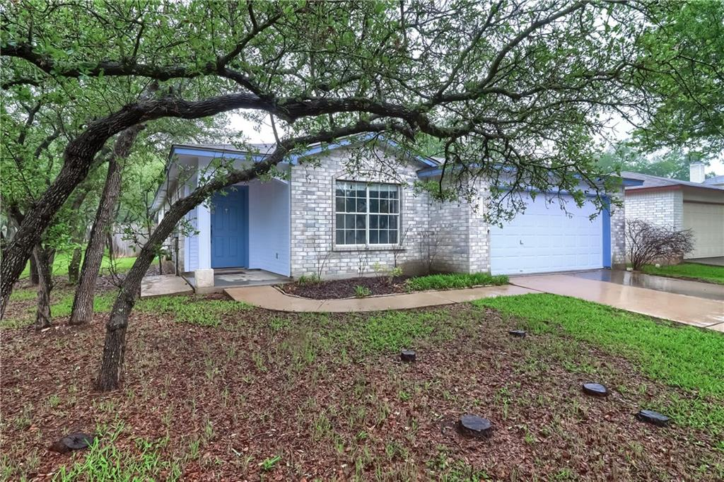 Charming one-story home in Cedar Park's Carriage Hills neighborhood. This home features 3 BD/ 2 BA, a sizable fenced backyard and a covered patio area. Located directly next to a park on one side, friendly neighbors on the other side. This well-maintained home boasts beautiful wood-like laminate floors (installed 2018). Other upgrades to this home include: New A/C installed 2017; New hot water heater installed 2019; Fence replaced in 2017; Disposal replaced in 2018; Dishwasher replaced in 2019; Exterior paint updated in 2018, and Interior paint updated in 2020. The kitchen opens beautifully through wide arching windows to the family room. The Owner's Suite features a private bathroom and walk-in closet. Spacious extra bedrooms. Quiet community-oriented neighborhood. Close to shopping, restaurants, schools, entertainment, and greenbelts. Quickly access 183 for a short commute to North Austin's bustling tech corridor. Zoned for top-rated Leander ISD. This excellent location and well-priced home will not last. Book an appointment for a showing today!
