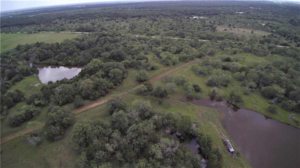 Great hunting/cattle property! Cleared pastures and a great mix of hardwoods. Two wells good fencing on most of exterior.  Three small Lakes provide excellent duck hunting. Well maintained 2 bedroom 2 bath home makes this one ready to go and enjoy!