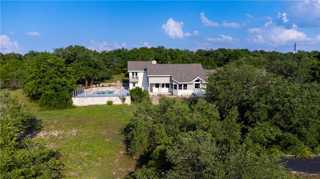 Fully renovated down to the studs and finished by Robillard Custom Homes in 2021. Uniquely private property with close proximity to shopping and entertainment as well as A rated Liberty Hill schools. No HOA and the only restrictions are single-family use only and cannot further subdivide. Hundreds of century old oaks, very usable terrain, long-distance views all the way to Lampasas and a sparkling spring-fed pond. Next to the pond is a 1900's cottage that was imported from Hyde Park in Austin. The cottage has 1 bed, 1 bath and is connected to water, electric and septic.
