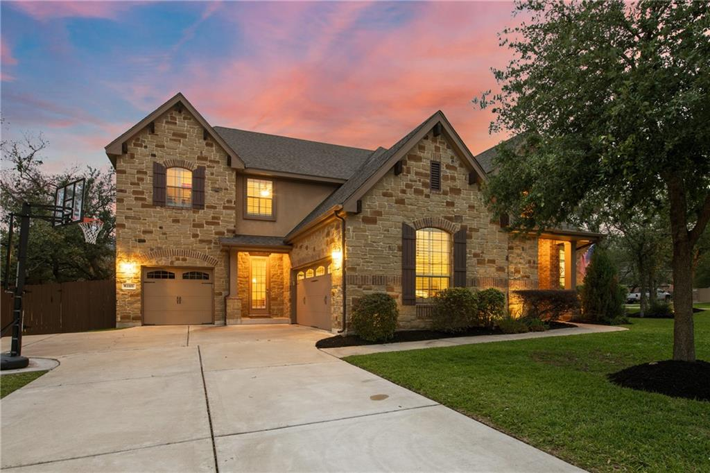 SPACIOUS AND WONDERFULLY SERENE HOME! Take a look at this gorgeous 5 bedroom, 5 bath home in one of the most sought-out areas in Williamson County, Cedar Park! Calm and sophisticated, this 4577 square feet home features many upgrades. The family room has wood floors, built-in speakers, stone fireplace and crown molding. Crown molding is also in the dining and the owner's suite. Separate raised vanities, walk-in closets, and a raised shower stall are found at the owner's bathroom. The stainless steel appliances, 46 inch kitchen cabinets, sliding drawers and double oven will make you feel like a masterchef! Have some fun at the elevated game room with a large storage closet or spend movie nights at the media room with built-in speakers for a cinematic experience! Ceiling fans and cable access in all bedrooms, study, family room, game room, media room & ODLA. The stunning home also features a private study, expanded laundry room, two new AC units installed in 2021 and more!   Get ready for summer! This home also features an in-ground swimming pool and the private oversized backyard makes for a great entertainment place. The outdoor living area has built in speakers, gas grille, and sink– a lovely way to spend hot Texas summer days in the pool or a weekend BBQ cookout with the fam! Experience true Austin living in this breathtaking, beautiful home!