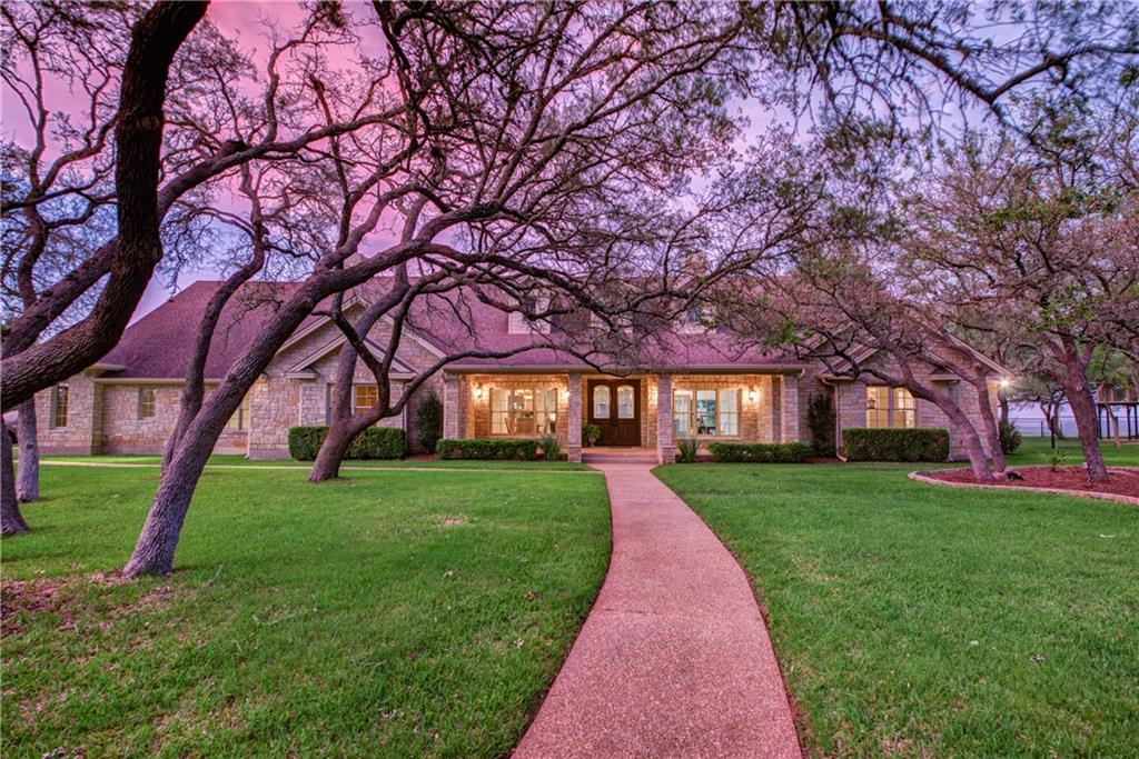 ULTIMATE PRIVACY AND SECLUSION YET CLOSE TO VIBRANT DT DRIPPING SPRINGS AND THE HILL COUNTRY WINE TRAIL. THIS CUSTOM HOME WAS DESIGNED FOR FAMILY & GUESTS TO HAVE PRIVACY WHILE ENJOYING LARGE CELEBRATIONS, IN AND OUT. MOST OF THE HOME IS ONE LEVEL WITH A BONUS UPSTAIRS. ENORMOUS MASTER SUITE WITH LUXURY BATH & EPIC CLOSET W/BUILT IN SAFE. BEDROOMS ARE LARGE AND SECLUDED, WALK-IN CLOSETS & STORAGE GALORE! EVERY BEDROOM HAS A BATHROOM. MAJESTIC POOL/JACUZZI WITH FOUNTAINS IS VERY VERY PRIVATE. BEAUTIFUL POST AND BEAM POOL CABANA AREA HAS COVERED OUTDOOR KITCHEN W/GAS, HALF BATH & OUTDOOR SHOWER,  5 CAR GARAGE, BARN/SHOP, RV PARKING, KIDS PLAY EQUIPMENT, TREEHOUSE, BASKETBALL CT., CROSSED FENCED, 2 GATES. WITH OVER 2500 SF OF COVERED OUTDOOR SPACE, YOU CAN ENTERTAIN COME RAIN OR SHINE. THE AREA AROUND THE HOUSE HAS FABULOUS TREES AND THERE IS A LARGE FENCED PASTURE THAT WILL SUPPORT LIVESTALK OR MANY HORSES. DRIPPING SPRINGS HAS EXEMPLARY SCHOOLS. TOUCHDOWN IN THE MIDDLE OF PARADISE!