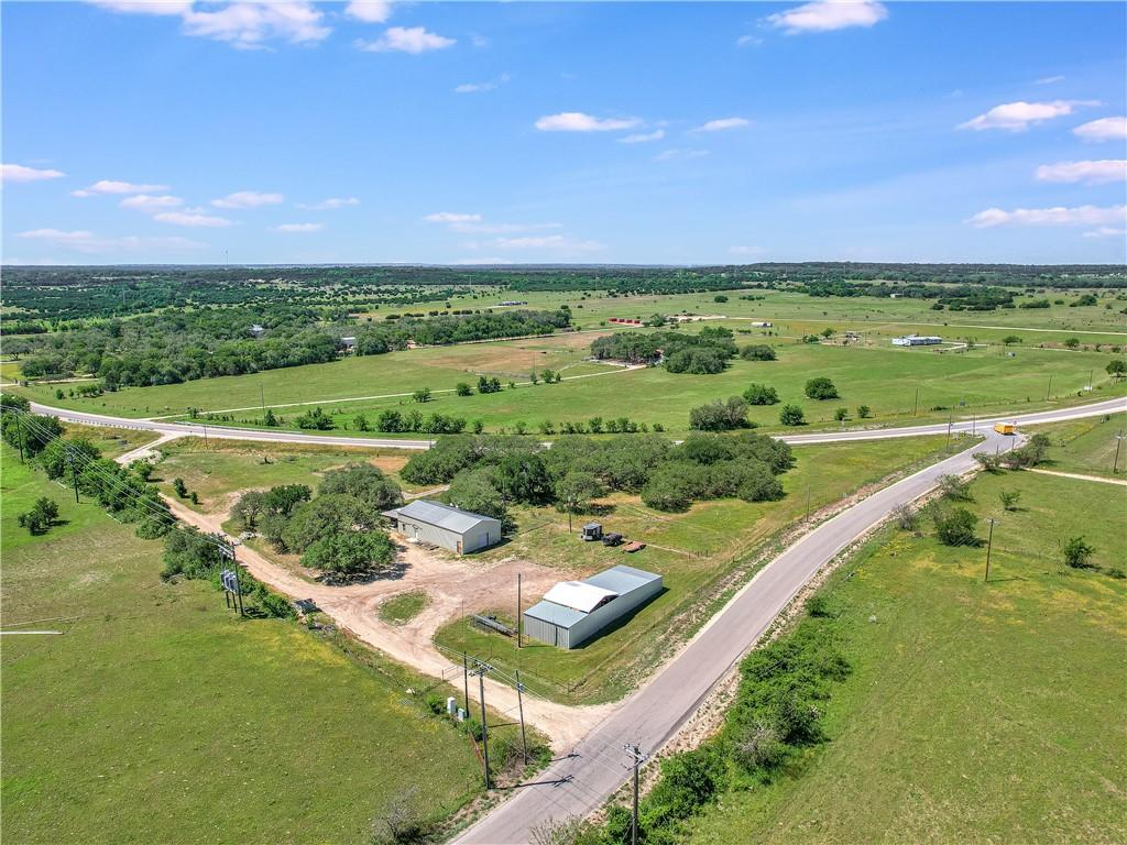 This property has NO RESTRICTIONS!  Great opportunity to live on property and run a business.  Road frontage on Williams Drive is 649 ft and road frontage on CR 241 is 574 feet.  Georgetown ISD.  3.14 acres.  Very efficient 3/2 bath barndominium, 30ftx60ft two story. Spray foam insulation.  Property completely fenced with gates on Williams Drive and auto gate on CR241. Shop is 25ftx80ft.
