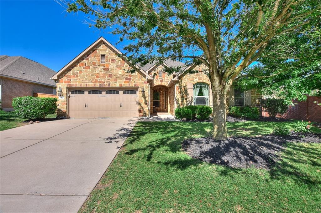 Stunning Single-Story Home in Amenity-Rich Teravista! Gorgeous Texas Limestone home w/high end finishes & upgrades throughout! 4 bedrooms+study, 2 baths & 3-car tandem garage on a corner lot! Enter at solid wood door w/leaded glass insert & you will be instantly impressed w/cathedral ceilings, open floor plan w/archways, fresh interior paint & custom cabinetry. Formal dining w/elegant trayed ceiling & chandelier. Warm wood floors & crown molding continue through most of the home w/carpet in only 2 bedrooms. The kitchen is the heart of this home w/gorgeous granite counter tops, walk-in pantry, stainless appliances, under cabinet lighting, stone accents at the gas cook-top, island w/stainless sink & custom built ins for cookbooks & wines. Breakfast bar features custom pendant lights & easily seats 3-4 & large breakfast area has a soaring bay window. Family room is open to other living areas w/a lovely corner fireplace. In-law floor plan has 3 bedrooms w/full bath at front of the home & primary bedroom at the back. Primary suite w/trayed ceiling & a wall of windows overlooking the backyard! Primary bath w/corner garden tub, separate shower, double vanities w/granite counters & big walk-in closet! Study offers a private space w/French glass-paned doors & a wall of cabinets to maximize storage. Large utility room also has cabinetry for extra storage. Large corner lot w/no neighbors on 2 sides w/full sprinklers, towering trees, covered patio, lush landscaping, low voltage lights & a beautiful flagstone patio. Additional upgrades include a Remi HVAC home purifier & water softener. You'll want to call this beautiful house your home for many years to come! Just 2 blocks to the primary pool/community center, 1 block to the golf center/cafe & 4 minutes to HEB. Teravista is loaded w/amenities including  golf course, multiple pools, parks, walking trails, clubhouse & fitness rooms. Great location w/quick access to major roadways including IH 35, 130 Toll & 1460/AW Grimes.