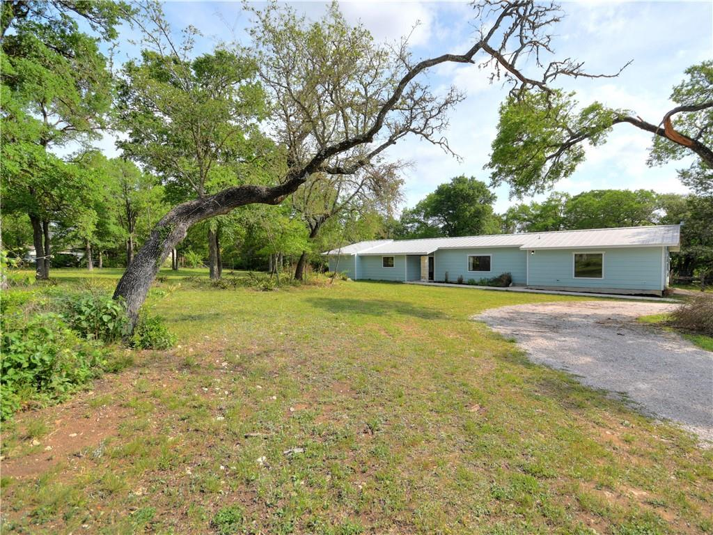 Beautifully updated home on just under 2 acres in Liberty Hill!!  This 4 bedroom, 2 bath home boasts an open floor plan and 3 living areas.  The tree-covered lot offers lots of shade, and the property is partially fenced.  There are a couple of outbuildings as well for storage of your tools and equipment!  Kids will attend the highly-rated Liberty Hill schools.  Just minutes to town...come own your piece of the hill country.