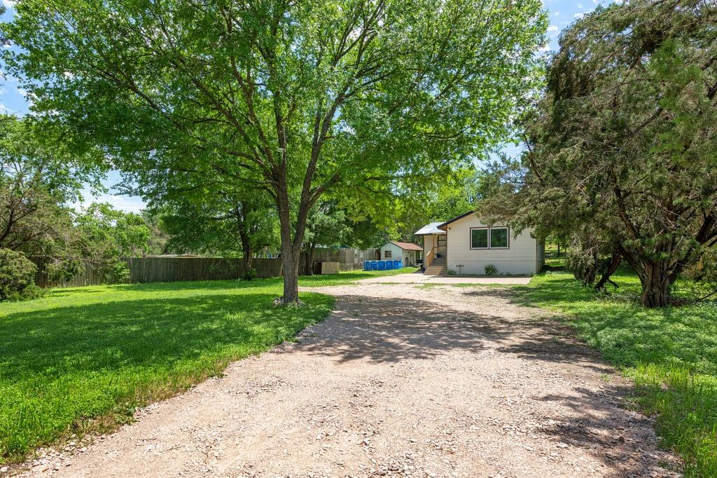 Country living  almost an acre with newly remodeled house,  open floor plan, laminate flooring ceiling fans, and remodeled kitchen.cabinets House consists of very unique features such as a double shower and steam sauna that you cannot find anywhere else, this can be converted back to the room if needed. Large deck on back for outdoor entertainment.  Large storage shed in backyard. Very private backyard with a lot of trees. Above ground 18 ft swimming pool.  New A/C system and New water heater. This community has  no HOA, No Zoning (ETJ).
