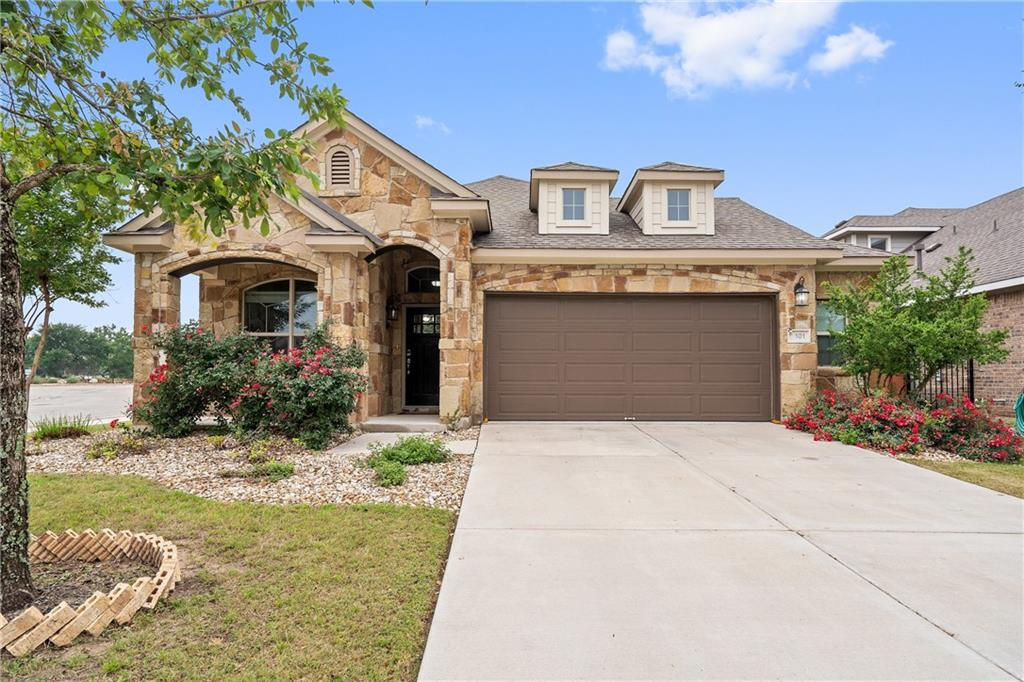 MULTIPLE OFFERS RECEIVED.  Highest and best due by 10:00a Monday.  Beautiful CORNER LOT home in the highly sought after community of Rancho Sienna.  This 3 bed, 2 bath, plus study sits on a cul de sac street and shows like a model.  Featuring an open floor plan flooded with natural light, wood floors throughout main areas and high ceilings, this home has been meticulously cared for.  Highlights include granite countertops in kitchen and bathrooms, stainless steel appliances, including an LG French door refrigerator, gas range, covered patio with outdoor curtains, newly stained fence, and an oversized private backyard.  The hill country community of Rancho Sienna offers 100+ acres of trails and open space, including a dog park, playgrounds, five stocked catch & release ponds, community garden, 24/7 fitness center, pool with splash pads, community center, covered pavilion and more.  Community is in top rated Liberty Hill ISD and this gem is a 2 minute walk to the private Primrose preschool and award winning Rancho Sienna Elementary.  Welcome home.