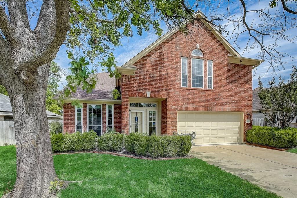 This Pflugerville two-story cul-de-sac home offers a patio, and a two-car garage.