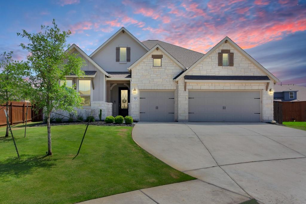 This is the home you've been waiting for! 1 story with all the bells and whistles. 4 bedrooms, plus an office and 3 full baths. This home features an open floor plan with beautiful wood look tile throughout. Custom navy cabinetry in a chefs dream kitchen, with a walk in butlers pantry. The master is tucked away on its own, so it feels like a secluded retreat. Large dining area is perfect for entertaining and open to the living room & kitchen. Custom wood beams installed in the living room give an extra luxurious feel. Located in highly desirable Santa Rita Ranch, this award winning resort style community in Liberty Hill features an array of amenities, including pools, water slides, splash pads, parks, miles of trails and on site elementary school.