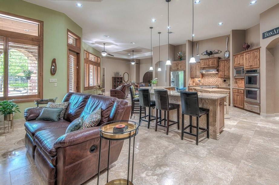 Your beautiful custom home is surrounded by mature trees, plants, dry river rock beds, xeriscaping, grassy areas, crushed granite, limestone paths, custom and color textured hardscapes. You are minutes from I-35, 130 Toll Road, parks, rivers, lakes, and shopping. This home allows for various configurations to suit your evolving needs. Numerous open and private office, study, or hobby spots. Multiple living and dining spaces. Private generous sized Owner's retreat with sitting area and private access to resort style outdoor living. There is plenty of space in the large room-size closet with built-in dressers and shelving. Three spacious secondary bedrooms are all ensuite and include walk-in closets with built-ins. Your dream kitchen is surrounded by a curved granite countertop that comfortably seats eight. Stone coffee/wine bar, walk-in pantry with extra refrigerator space. Abundant storage in custom alder natural wood built-ins throughout from the large laundry room to the mud room. Soaring ceilings, vast windows with custom plantation shutters, wood, luxury large plank vinyl and Travertine flooring, stone fireplace and more turn this house into your home. Relax in your backyard oasis with its immense patio and wood plank ceiling covering the outdoor kitchen, living and dining, and fireplace. One step down to the spacious pool decking and sparkling saltwater pool with a water wall and swim jet. Your gas firepit situated beyond the pool in a cozy crushed granite garden surrounded by trees and rose bushes is perfect for chilly times or roasting marshmallows. Your light and bright home is filled with smart features including a security system, outdoor cameras, landscape lighting on front walls, several Lutron smart dimmers and lighting controls, video/audio doorbell, and keyless front entry. All can be controlled via apps. Your new home is ready for relaxing in privacy, enjoying family, entertaining, playing indoors or out.  Owner is a Tex Lic Real Estate Broker.