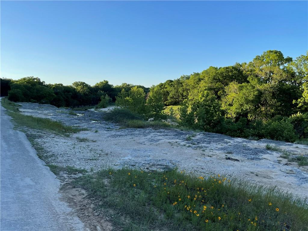 Are you looking for a paradise with little to no restrictions? This wildlife-exempt 30-acre slice of heaven is sitting on the Lampasas River. It has scenic views, a 5k sqft Quonset Hut, a 500 Gallon Fresh Water tank. The views are absolutely beautiful. It is wooded and secluded for optimal privacy.