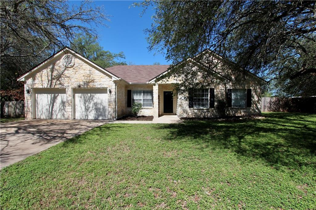Adorable home on an oversized lot in the heart of Liberty Hill.  Large oak trees cover this property to provide lots of shade.  The house has been freshly painted inside (5/5/21), and has hard surface floors throughout, granite countertops in the kitchen, stainless steel appliances, and is move-in ready.  The front room can be a formal dining or office space.  Large storage building in the backyard.  Kids will attend the highly acclaimed Liberty Hill schools!