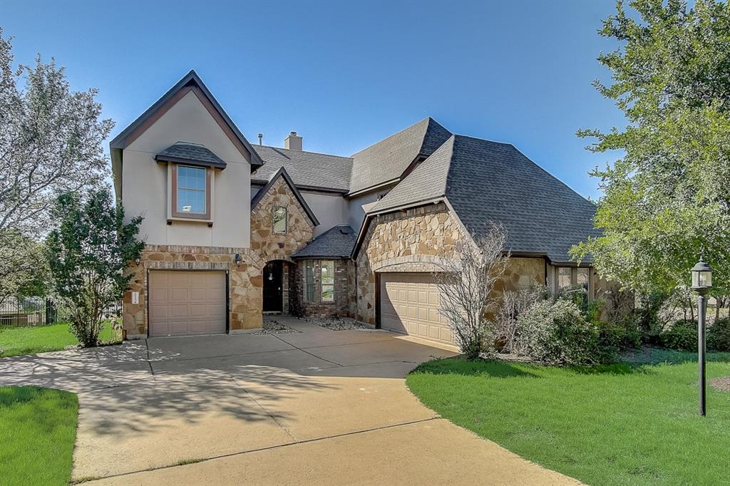 This Austin two-story home offers granite countertops, and a three-car garage.