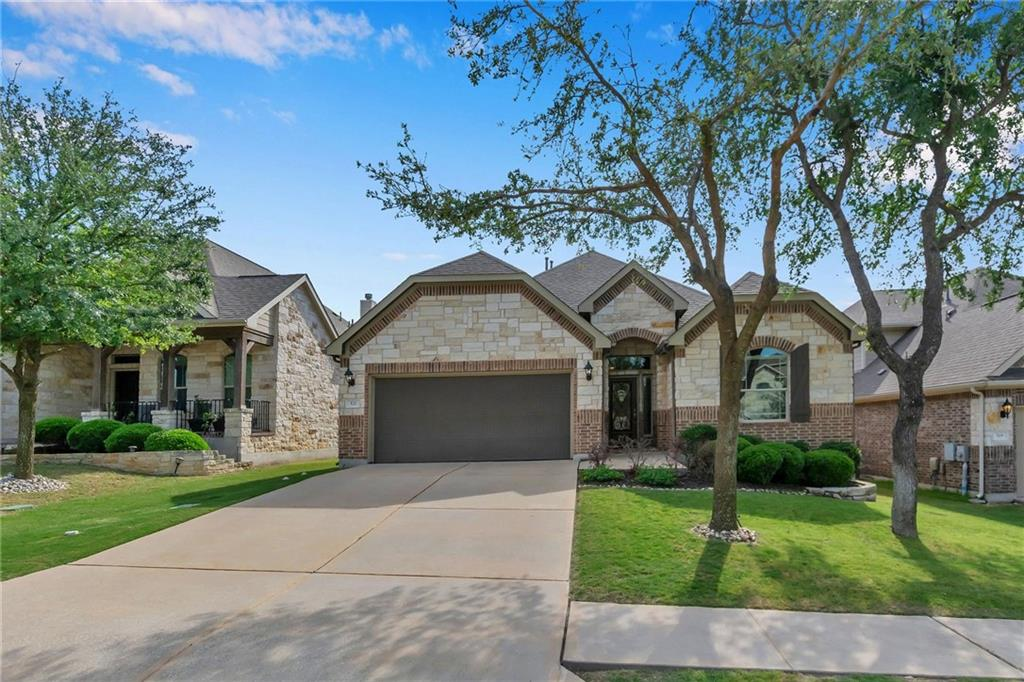 An exceptional opportunity exists to secure this beautiful one-story home in pristine Walsh Trail. The beautiful exterior features a mix of rock and stone siding, full gutters and meticulously maintained landscaping all combined to create an inviting ambiance. Upon entering the home, attention is drawn to the high ceilings with crown molding, neutral toned walls and the abundance of natural light. The home opens up into a generous area that accommodates the kitchen, living and dining room. The kitchen is very much the heart of this home with stunning design features, granite countertops, stainless appliances and an abundance of countertop and storage space. Light and space has been maximized in the open-plan living area with a large picture window that looks into your private backyard. The ultimate place to kick back and relax on a lazy day is in front of the gas log fireplace. The private owner's room was designed for the ultimate relaxation with high ceilings, a ceiling fan and plush carpet. Enjoy the separate vanities, melt your stresses away in the spa-like jetted tub or let a cascade of hot water rejuvenate you in the step-in shower in the oversized, ensuite bath. The layout of the secondary bedrooms offer extended family members much needed privacy, space and comfort. The outdoor area provides a relaxed and stylish space for entertaining family and friends. This home also comes complete with updated water heaters (less than 3 years old), updated toilets, new fence and a new roof being installed before closing. This gorgeous home is conveniently located within walking distance to Brushy Creek trail, lake. splash pad and parks. Zoned for award winning schools! Act quickly - homes in this desirable location do not last long!