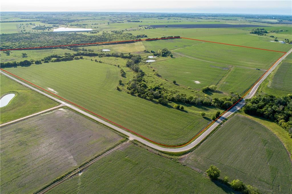 152 +/- acres of gorgeous farmland near rapidly-growing Taylor and the busy Hwy 79 and Hwy 95 corridors. A fantastic buy & hold investment property with more than a mile of County Road frontage where you can enjoy hunting, fishing, farming and ranching while the area continues to grow, and have income potential from grazing and crop leases. The fertile farmland is producing corn, and the grazing pastures include large scattered Texas cedar elm trees, sycamore, and other native trees and grasses, and level to sloping topography with 60+/- feet of elevation change from creek in center to north and south boundaries, creating expansive views of the countryside. Includes a wet weather creek, a 1,000 +/- square foot metal storage building, and 3 stock ponds. Waterline at the road by Manville Water, old well, and electricity at the road by Oncor. Minerals are unknown. Currently leased for crops and grazing.