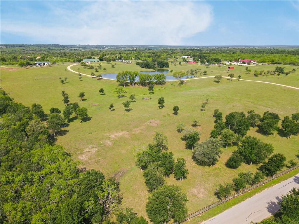 Beautiful 20.622-Acre Lockhart Ranch!  2 Bed/1 Bath home with covered porch and beautiful views of pond and pastures.  Large pond, barn, cattle/horse pens, pool, and dog kennels.  More photos coming soon.