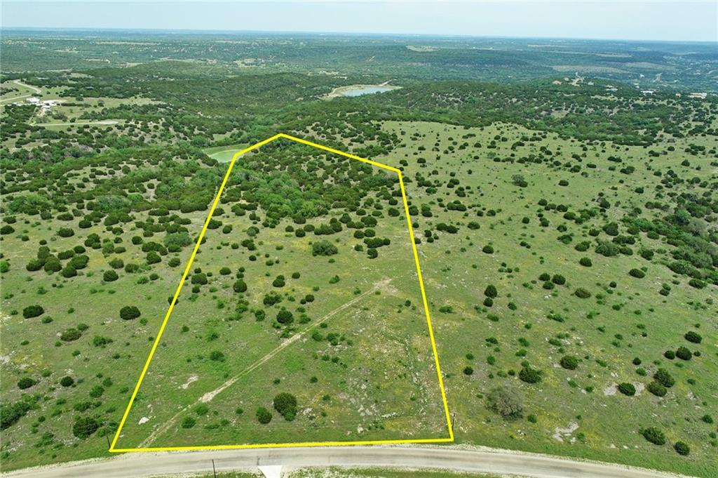 Once in a lifetime property to build your dream home.  The high top of the 26 acres offers natural homesites overlooking deep and forested canyons.  Springs feed the pristine fishing pond.  Features endless views, back to Balcones Canyonlands National Wildlife Refuge.  A water well and holding tank are in place, hunting allowed, and partial foundation can be repurposed.  Contact us or your agent fur survey plat, water well report and restrictions.  The Ranches at Canyon Creek connects to a gated community and offers a quiet Texas hill country escape.