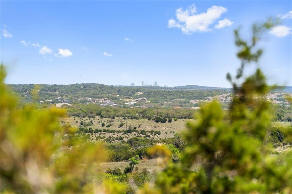 You don't want to miss out on the most unique property in Travis County,  SHINGLE HILLS Ranch, located 10 minutes from the Hill Country Galleria and 30 minutes from Downtown Austin.   Build your custom home on one the highest hill tops in Travis County. Sitting 1400 ft. above sea level, this flat hill top has distant views of downtown Austin, an almost 360 degree view of the hill country, and is surrounded by a heavily treed 33.6 acres acres of Live Oaks.   The paved flat and winding driveway leads you to the 2500 sq. ft bunk house used for family gatherings and weekend get-a-ways that comes turn-key with ranch style furnishing purchased in Fort Worth, Texas. The screened in porched looking into a tree grove and fire pit is perfect way to unwind for the evening.   The 1500 sq. ft. metal barn comes with electricity and is a great place to store the farm implements that convey with the property.   You don't want to miss out on owning this slice of heaven in the heart of the Austin Hill Country.  Additions:   * 3 water wells, electricity, and septic  * AG exempt  * wet weather pond  * New survey  * 1.9% tax rate * Highly acclaimed LAKE TRAVIS School District