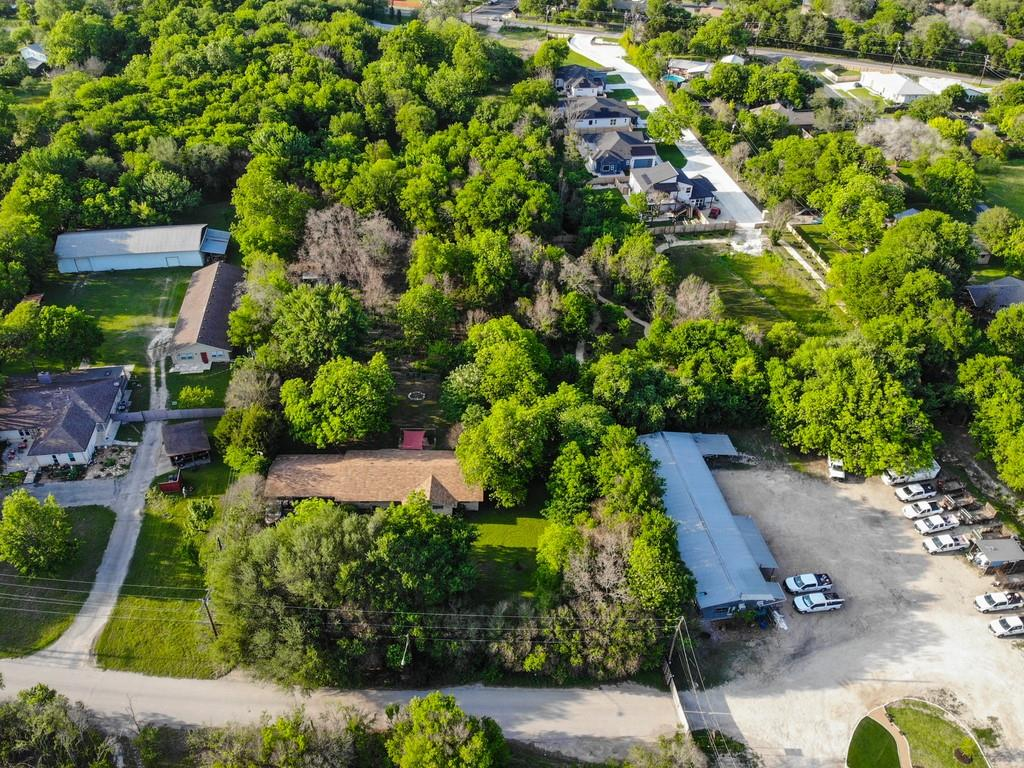 Unique opportunity in South Austin's highly desirable 78745 zip code on 1.335 acres (per survey). Zoned DR-Development Reserve by City of Austin, the relatively flat lot boasts mature pecan, apple and oak trees. Located in Elmwood Estates with excellent potential for builders, investors, or the owner to build a dream home estate. Tear down existing structures and build multiple structures with rezoning and subdividing process, or repair existing foundation and remodel to make your own. Preliminary Property Profile report available for recommended highest and best use of the land. Buyers to independently verify all information.