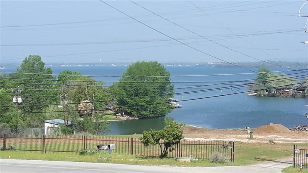 Awesome  water views of this one of a kind property. Highway access off FM 2147 gives the buyer a wide variety of uses. This property is in the ETJ of Cottonwood Shores. Also comes with a 1/25 UDI park reserve. The buyer may use as residential, commercial, multi-family etc. The buyer will verify title and deed restrictions to determine the use and zoning.. This property comes with water access of Lake LBJ. Water views and access, what more would you want? This home with a little  of TLC will be perfect for your family and vacation rental..
