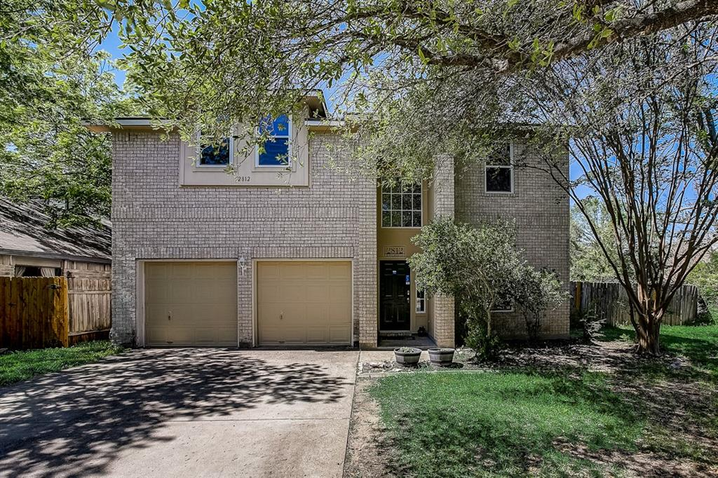 This Leander two-story cul-de-sac home offers a patio, granite countertops, and a two-car garage.