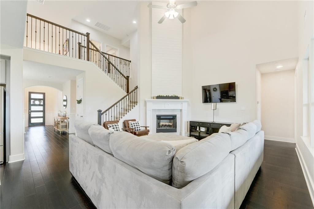 Don't miss your chance to own this upgraded Highland home in Parkside at Mayfield Ranch! Walk into a beautiful two story entry way that leads to a modern kitchen and open family room featuring a cozy, corner fireplace. Downstairs also includes a home office, formal dining room, primary bedroom and bathroom, as well as a guest bedroom and bathroom. Upstairs, you will find a game room, play room, and media room in addition to 3 more bedrooms and 2 bathrooms. Plenty of space to host friends and family, or unwind with your favorite movie in your own media room. With a ranch property behind the home, you will love the privacy this backyard has to offer. Relax on the oversized covered back patio. Backyard offers plenty of space for a pool. Home features custom upgrades throughout, including: office cabinets and bookshelves, built-in mud area, wood shutters, and wainscoting throughout the main level and so much more! Neighborhood amenities include: two large swimming pools, two parks, an amenity center, and walking trails that lead to nearby Williamson County Regional Park. Also onsite is Leander ISD's Parkside Elementary School. Parkside is a quiet, private neighborhood with quick access to 1-35, 183, and Ronald Reagan Blvd. Nearby, there is plenty of shopping, restaurants, gyms, and entertainment. This home will not last!
