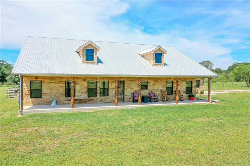 Are you looking for a dream country home w/cleared land for livestock or horses, wooded acreage for recreational or hunting, a pond & creek? Then WELCOME HOME! Beautiful custom 3/2 home w/attached 2 car oversized garage on manicured 23.661 acres w/24'x30' shop, 24'x30' pole barn, loafing shed for cows, a pond & seasonal creek running through. Home inc. wood flooring, doors & cabinets, granite countertops, spray foam insulation, tankless water heater, energy efficient stainless steel appliances & double pane windows, open concept living/dining/kitchen, kitchen cabinets deep for pots & pans, double oven, rock wood burning fireplace w/gas starter & wood mantle, recessed lighting & ceiling fans throughout home inc. front & back porches, cedar posts on porches, walk-in pantry w/built-in shelves, office in utility room w/attic access, large primary bedroom walk-in closet w/shoe cabinet, primary bedroom ensuite inc. walk-in shower w/rock floor, jetted soaking tub, & 2 vanities, & much more. Shop inc. 2 window units, lights, & ceiling fans. Attached 2 car oversized garage is insulated w/lighting & attic access. Fridge, double ovens, microwave, ice maker, dishwasher, & washer/dryer will convey. Fully fenced & cross fenced. Fencing inc. pipe entrance w/electric gate, wood, barbed wire & wire. RV hookup. Septic, county water, & propane. Deed Restrictions. No minerals or leases. Ag exempt.