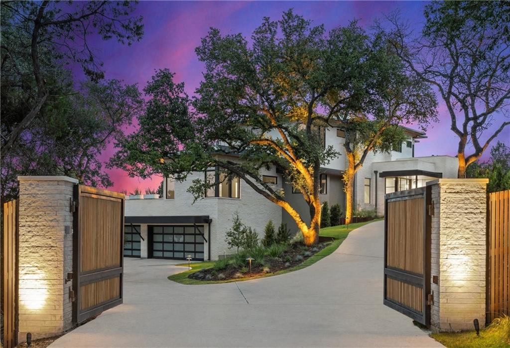 With panoramic views of downtown Austin from every vantage point, this stunning home brings timeless beauty to contemporary design. For those seeking both exclusivity and proximity, this idyllic 0.88 acre haven enjoys the privacy of West Lake Hills, with easy access to downtown - and the coveted Eanes ISD. Designer lighting fixtures, Cherry Laurels and Japanese Yews sweep alongside a privately-gated drive; a 5-camera security system is integrated seamlessly into the stucco-and-limestone exterior. Step inside the main entrance to find 12 ft. high ceilings, sliding glass doors, a Sonos sound system, and custom design details at every turn. Clean lines create graceful movement through the spacious floor plan, while natural light brings the outdoors in. A heated infinity pool and spa accompanied by over 1500 sq. ft. of Garapa wood terrace beckon for lounging in resort-worthy surroundings. An inviting kitchen features top-of-the-line appliances, elegant cabinetry, and stone countertops. Move beyond the kitchen to an airy living space and Venetian plaster fireplace. A separate dining area offers an intimate space for mealtimes, while around the corner you'll find a private study - complete with ensuite bathroom and terrace access. A half bath and laundry room provide premium convenience. The primary suite is home to a magnificent walk-in closet and a dreamy, spa-like bathroom: a stone soaking tub, glass shower, and sit-down vanity are just a few of the highlights. Up the floating staircase to the third floor, you'll find 3 bedrooms with walk-in closets, 2 with ensuite bathrooms. A spacious playroom opens onto a covered east-facing terrace, while an additional laundry room and bathroom offer same-floor convenience. Next-level entertainment can be found on the ground floor, which houses a media area, wet bar, powder room, and access to the 3-car garage. Undeniably elegant and infinitely liveable, this is a house waiting to be called home.