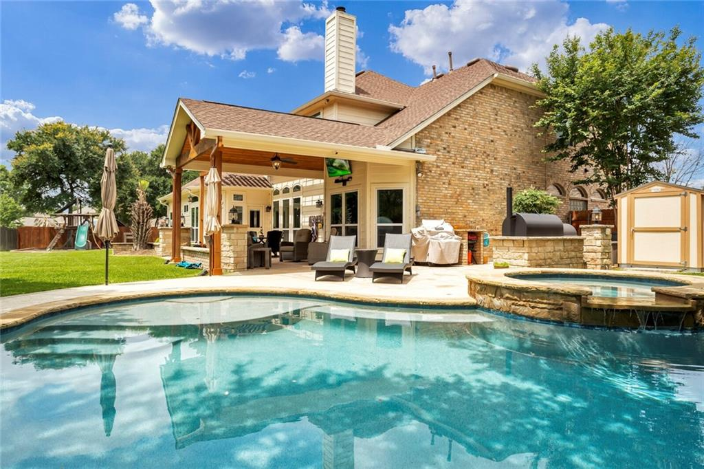 Rare pool home on West side of Round Rock on an oversized $100K lot premium that backs to green area!  $200K in upgrades all throughout! Over 3800sqft with added media room (could convert back to 3 car garage if wanted.) Full kitchen remodel with tons of cabinet and counter space, huge island, granite counters and high end appliances all open to the living room. Newer pool with hot tub, added arbor, covered patio, built in Texas BBQ pit, and storage shed. 5 bedrooms plus an office plus a media room plus game room with open office area. Newer Trane ACs, some newer windows, added insulation and gutters. Gorgeous master bath remodel with granite counters, frameless shower and his & hers closets! Convenient to shopping and everything in sought after area!