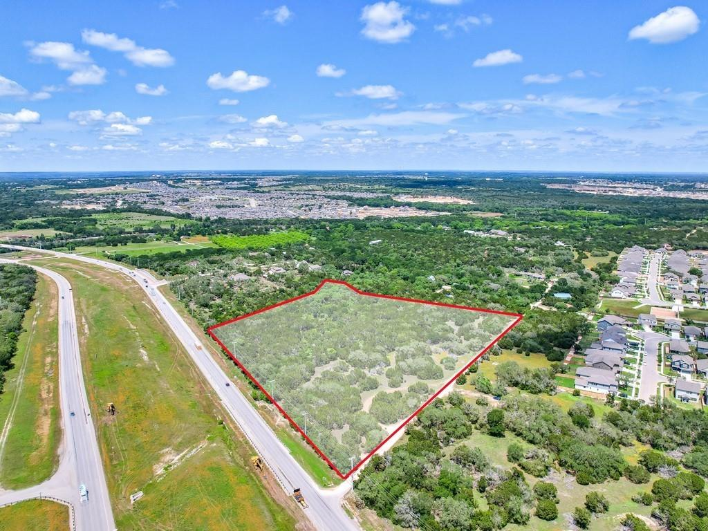 This is very rare vacant land on the 183 access road in the City of Leander, right in the middle of development. City services are available or nearby. Future zoning (according to the Leander planning and zoning department) is for mixed use local commercial or local office. Current zoning is SFS-2B. City zoning docs are attached. Plans are under development on Phase III of the 183A tollway to extend the roadway from it's current ending at Hero Way northward to just past State Highway 29.