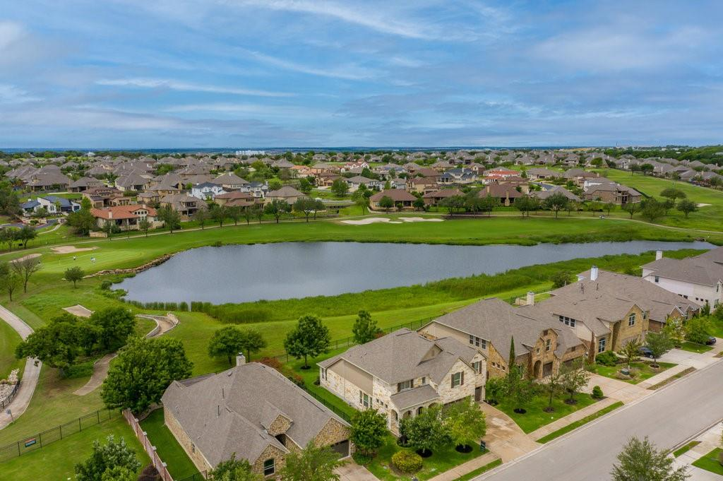 Incredible home ideally located in the award-winning master-planned community of Teravista w/ amazing views of the community golf course & pond. Fantastic open floorplan for entertaining. The family room features a 2-story vaulted ceiling w/ fireplace and an iron staircase that offers a very luxurious feel. Tons of windows provide lots of natural light and stunning views of the 12th hole of the Teravista golf course as well as a beautiful fishing pond. Luxury hardwood floors and electronic shades throughout much of the lower level. Exposed wooden beams in the dedicated office w/ glass french doors. The kitchen is open to the living room and features a stone wall surrounding the 6 burner gas cooktop. Exquisite master bed & bath, media room & separate game room upstairs. Oversized laundry room and drop zone, covered front porch, 3-car garage. Gorgeous covered outdoor living with breathtaking views and privacy over a meticulously maintained lawn & landscaping. Community hike and bike trails out your back door. < 1/2 mile walk to Teravista Elem, < 1/2 mile to Teravista golf club. Walk/bike to Round Rock Premium Outlets for Dining & Shopping. Exemplary RR ISD.