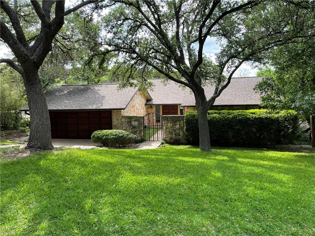 Perched on a hillside, this custom split-level home offers tree-top views, large back decks, and a gated courtyard just minutes from Downtown Austin, the Arboretum, and the Domain.  Living room has vaulted and beamed ceilings with a wood burning stone fireplace. Located on 0.43 acres in the coveted Beverly Hills subdivision.