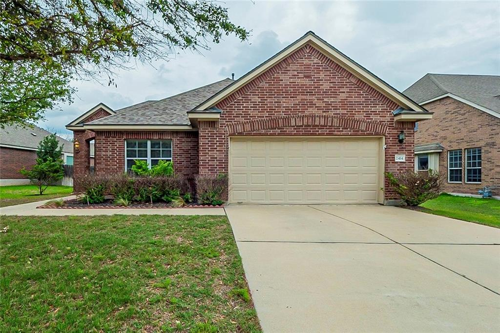 This Leander one-story cul-de-sac home offers a patio, and a two-car garage.