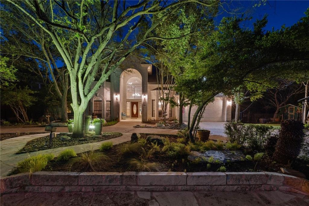 This nature-centric property with unbeatable views is nestled in the Spicewood at Bull Creek neighborhood in highly sought after Northwest Hills & zoned to exemplary Round Rock ISD & award winning Westwood High School. Immaculate curb appeal & professional landscaping showcase the gorgeous entrance to this gem of a property. The sprawling floor plan offers flexibility & opportunities galore & features two true primary suites w/ one of the suites on the main level that contains a full bath & sound proof room w/ extra insulation. The upper level primary suite is also equipped w/ a full bath in addition to a large walk in attic space w/ flooring & stackable washer / dryer hookups.  A few notable features of the home (as there are way too many items to list) include- a 700 sq ft guesthouse (not included in the main house sq ft total) that includes a full bath, stackable washer/dryer & phenomenal bar made from a single piece of live oak wood, floor to ceiling windows, tons of storage space & attic space, a 1000 sq ft deck w/views for days, spacious kitchen with double oven, subzero refrigerator, tons of counter space & cabinets, multiple dining areas, laundry room with butler pantry, hot water circulating pump to upstairs, large game room / flex space upstairs also complete with a walk in attic & flooring.  There are 5 bedrooms + an office/study or the office/study used as a 6th bedrm. The well thought out house is a beautiful combination of ease & function yet the outdoor space is the ultimate oasis for outdoor living. The private backyard contains wrought iron fencing, dog run, garden house/studio/workshop space, life size dollhouse, covered deck area situated near the Koi pond / fountain that has extra seating & ceiling fan & ample room to install a swimming pool. The property extends all the way to the creek & sits within the bounds of the Golden Cheek Warbler Preserve, ensuring no structures will be built to obstruct the tranquility or the views.