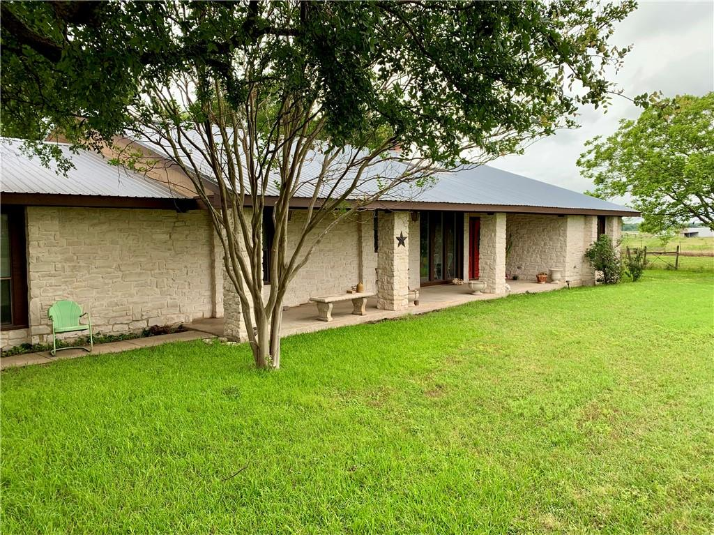 The possibilities are endless with this one Folks! 38 +/- UNRESTRICTED ACRES, fully AG EXEMPT w/ country home! This home/floorplan was featured in Southern Living Magazine which inspired the owner to build it! Beautiful country setting that has easy and quick access to HWY 290. Property would make an ideal investment opportunity because of its proximity to 290/TESLA/Austin Bergstrom International Airport! Or better yet an awesome family/gentlemans ranch. there are 2 stock tanks, horse/cattle barn, shed for storage, hay or tack. The views are breathtaking especially when you catch that Texas Sunset! Great all around Texas Ranch Property that offers endless opportunities!