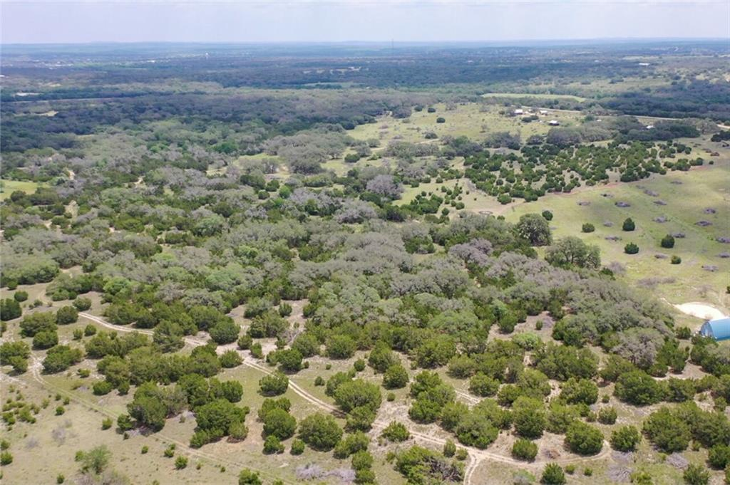 Stunning 38+/- Acres to be surveyed on Flat Creek Road, just minutes from downtown Johnson City. Choose from multiple building sites on gently rolling terrain. You'll enjoy quiet days, spectacular sunsets, and star-filled nights. Within easy driving of the renowned Texas wine region, restaurants, shopping, and state parks for recreation and history, yet, secluded and private. Diverse flora and fauna on the property, including native grasses, wildflowers, Live Oaks, Spanish Oaks, and Red Buds. Currently under wildlife tax exemption. Perfect for horses, vineyard, nature enthusiasts, and bird watchers. New entrance gate recently installed. Fenced on three sides. Come build your dream home on this rare gem of a property in the heart of the Texas Hill Country. Must see to appreciate this gem of a property.