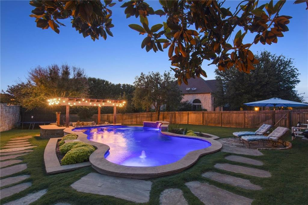 One of a kind! This Avery Ranch-Brookside home is built with an additional lot that showcases the stunning pool, swim-up bar and spa. Quietly located on a 3/4 cul-de-sac, this 1-story boasts 11ft ceilings, minimal carpet and an open floorplan for everyone to enjoy. Homes in this section of Avery Ranch don't become available too often and are in high demand for the exemplary LISD schools and proximity to the Parmer Lane technology corridor.