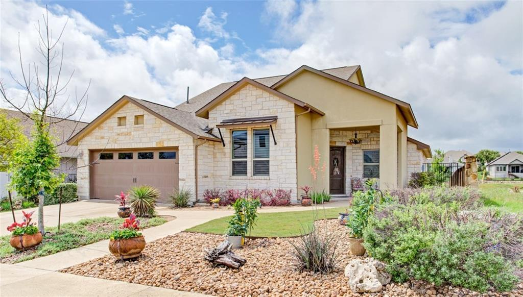 Nestled in the sought-after, master-planned community of Rancho Sienna, this rare lock-and-leave gem has nabbed one of the best view/greenbelt lots in the neighborhood! From the exquisite Texas stone and stucco exterior to the lush, manicured front gardens, you'll swoon for the sheer beauty and curb appeal. Step inside, and the rich tones, upscale finishes, and elegant wood grain tile floors rush to greet you. The open layout with the perfect blend of designated spaces facilitates a lifestyle of gatherings and entertaining in seamless enjoyment. The kitchen is a show-stopper, complete with a giant, truly functional island with casual eating area, sprawling granite countertops, soaring cabinetry, stainless steel appliances, recessed and pendant lighting, and subway tile backsplash. Fit for royalty, the owner's retreat features lovely neutral tones, upgraded lighting, French doors to the blissful backyard patio, and an ensuite resembling a resort spa. Relish the fantastic oversized shower, double sinks, and walk-in closet, complete with an organizing system from California Closets. We've saved the very best for last...step onto the covered patio's outdoor living area and soak up the spectacular view of the fishing pond, walking trails, and greenbelts. Imagine hosting evening BBQs with friends and loved ones around the outdoor fireplace with TV connection. Look no further...you've found HOME.