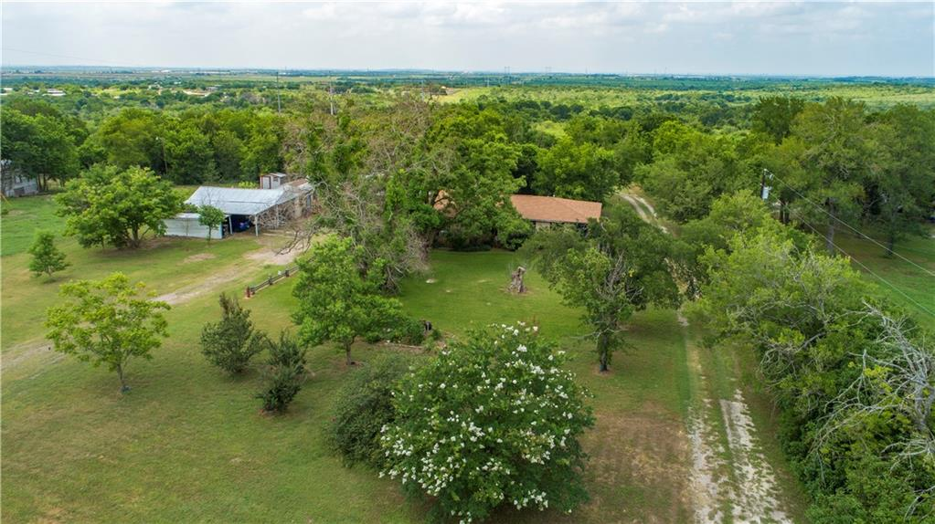 2 HOMES 10 ACRES.  This property is ideal for a contractor or anyone needing space and still being close to everything!  Austin is within minutes! Rare 10 acres in prime location! Located in the  Austin skyline area! No known restrictions. 2 minutes from corner of 183/45/130. 2 homes, 3 water meters, 2 electric meters, 2 septics. 15 miles to ABIA Airport. 6 miles to Circuit of the Americas. 16 miles to the new Tesla site. Older Home built in the 40's (per owner) with 3 bedrooms, 2 bathrooms, 2 living rooms, 1 dining room, kitchen equiped with real wood cabinets! Original hardwood floors.  Also, includes a 1997 Doublewide 3bed/2bath with front and back porches. Property equiped with 892 sq ft of workshop space, 882 sq ft tall carport where Fire Trucks were once serviced.