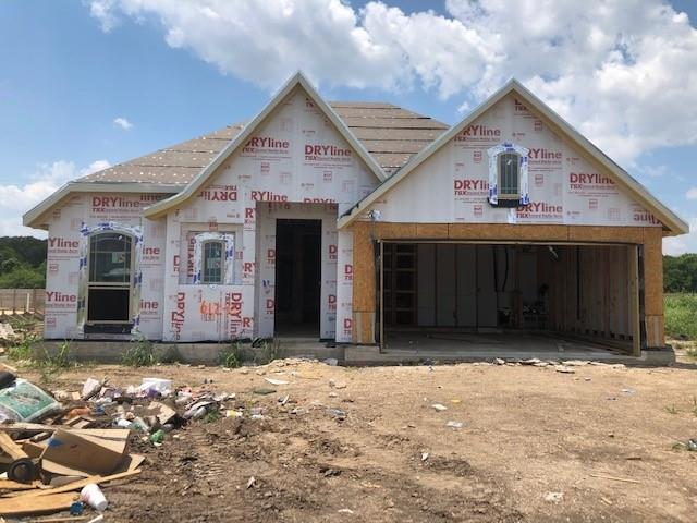 Popular Laurel floor plan with features that include a formal dining room, covered patio, built in appliances, pre plumbed for water softener loop, full sod and sprinkler, full gutters. Available August.